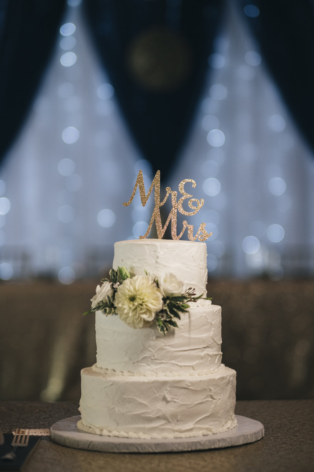 The bride and groom's wedding cake is from Cigi Cakes custom design in Marblehead Ohio