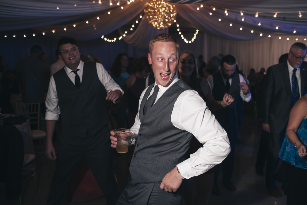 Groom dances at his lake Erie wedding reception