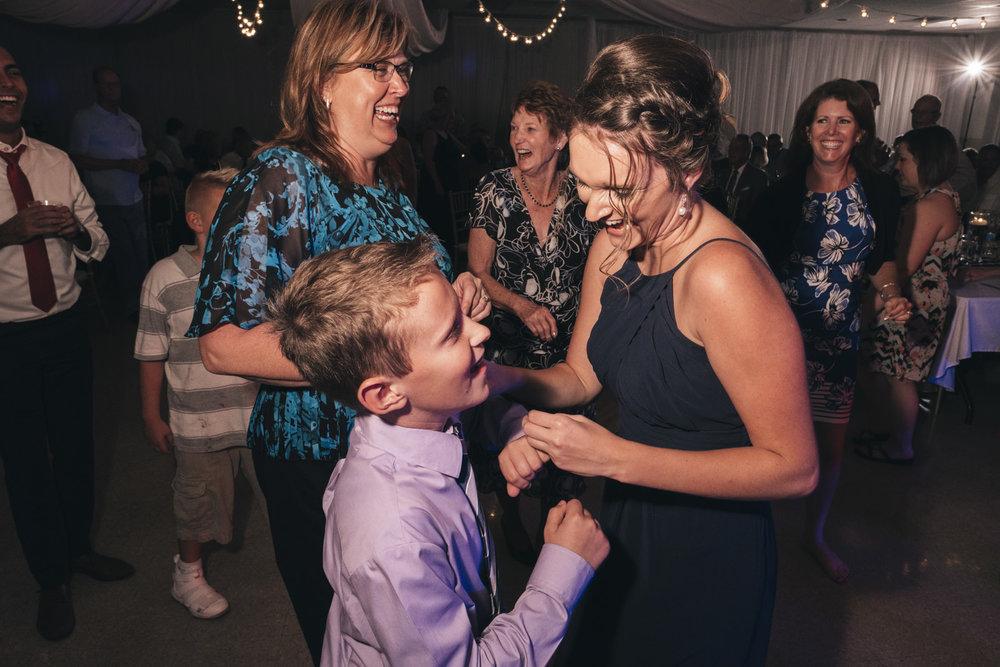 Guests dance at a fun wedding reception venue at Marblehead Ohio wedding venue reception