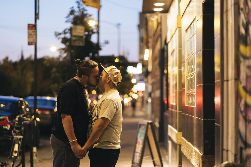Couple kisses outside The Owl on the streets of Chicago in early fall