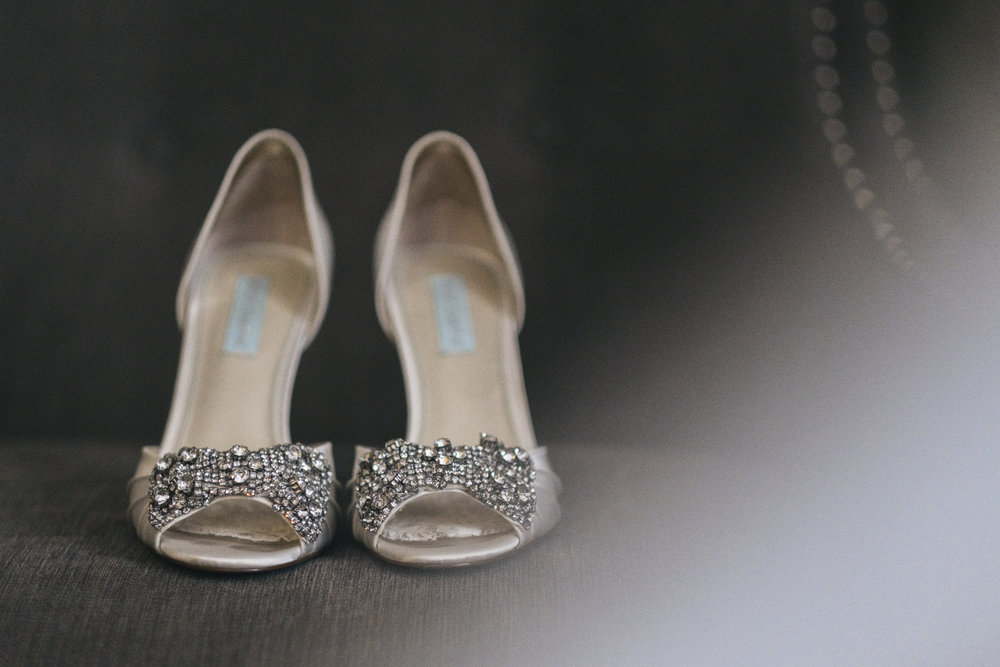 Detail image of the bride's shoes, complete with sparkles and bling for her early fall wedding