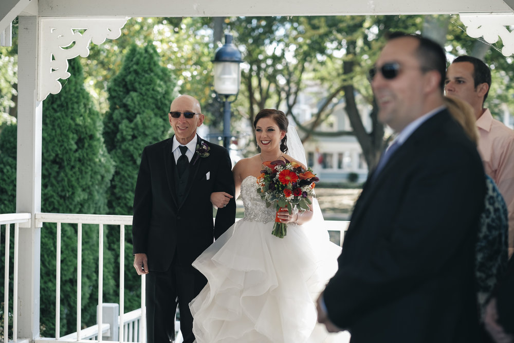 Bride walks down the aisle with her father for her Lakeside Chautauqua wedding in late September