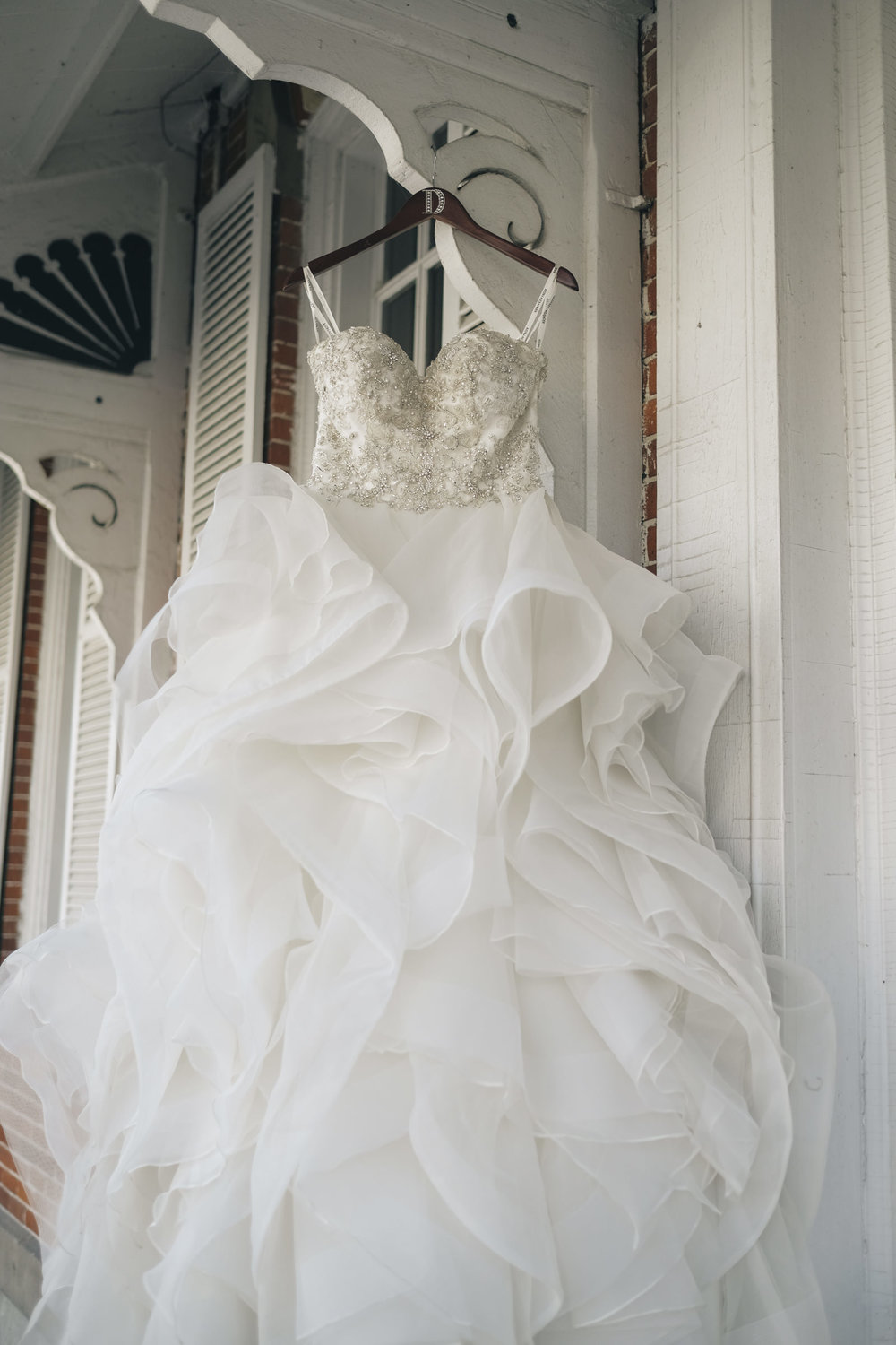 Beautiful fluffy wedding dress from Belle Amour bridal is strapless and features many sparkles and bling