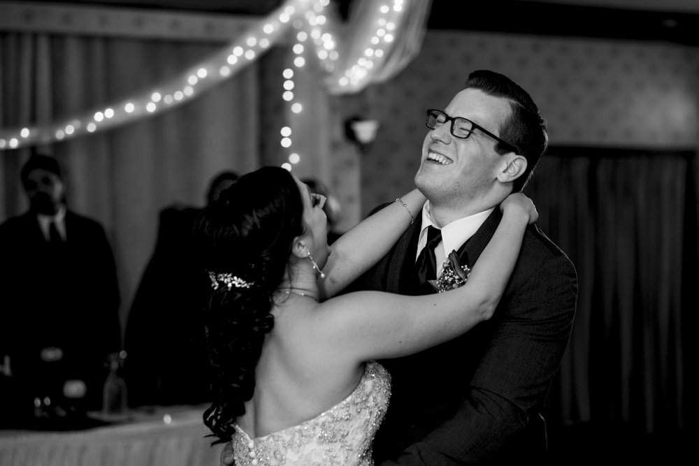 Bride and groom dance their first dance as husband and wife during their wedding reception, Lake Erie