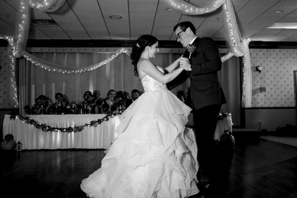 Bride and groom dances their first dance at Port Clinton Elks Lodge wedding