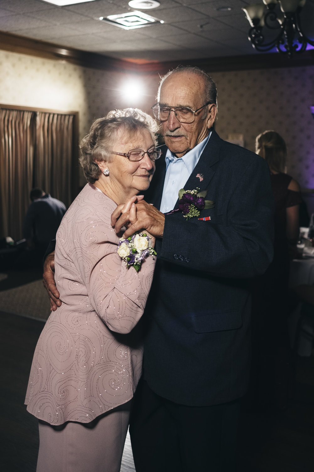 Cute couple dances during anniversary dance at Northern Ohio wedding reception