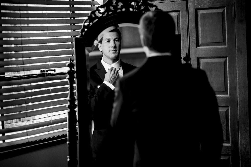 Groom gets ready before his wedding ceremony at Nazareth Hall