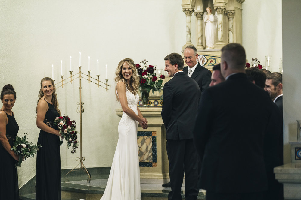 Bride smiles and laughs during wedding ceremony in Northwest Ohio
