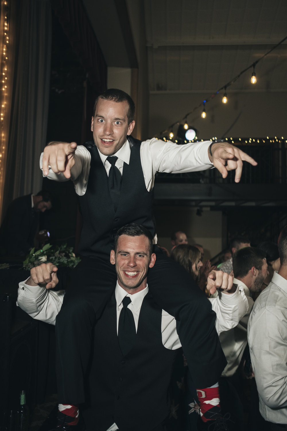 Groomsmen have fun at Toledo, Ohio wedding reception at Nazareth Hall