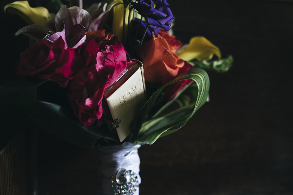 The bride's colorful floral bouquet sits in the window before her wedding ceremony in Toledo, Ohio.