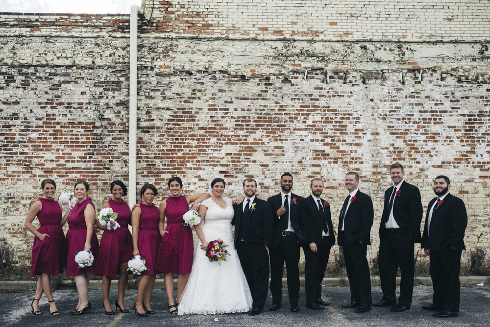 The bridal party lines up for a picture with the bride and groom after their wedding ceremony in Northwest Ohio