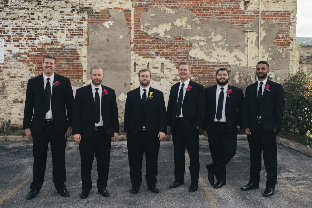 Groomsmen stand with the groom for a picture by Toledo wedding photographers in Ohio