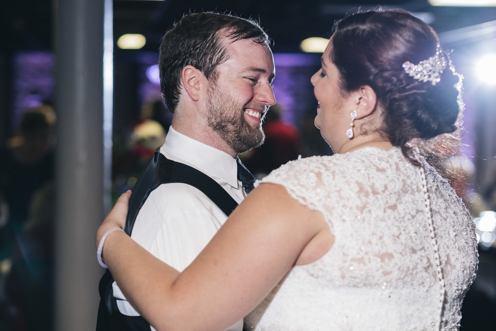 Bride and groom share their first dance on the dance floor of Top of Nine