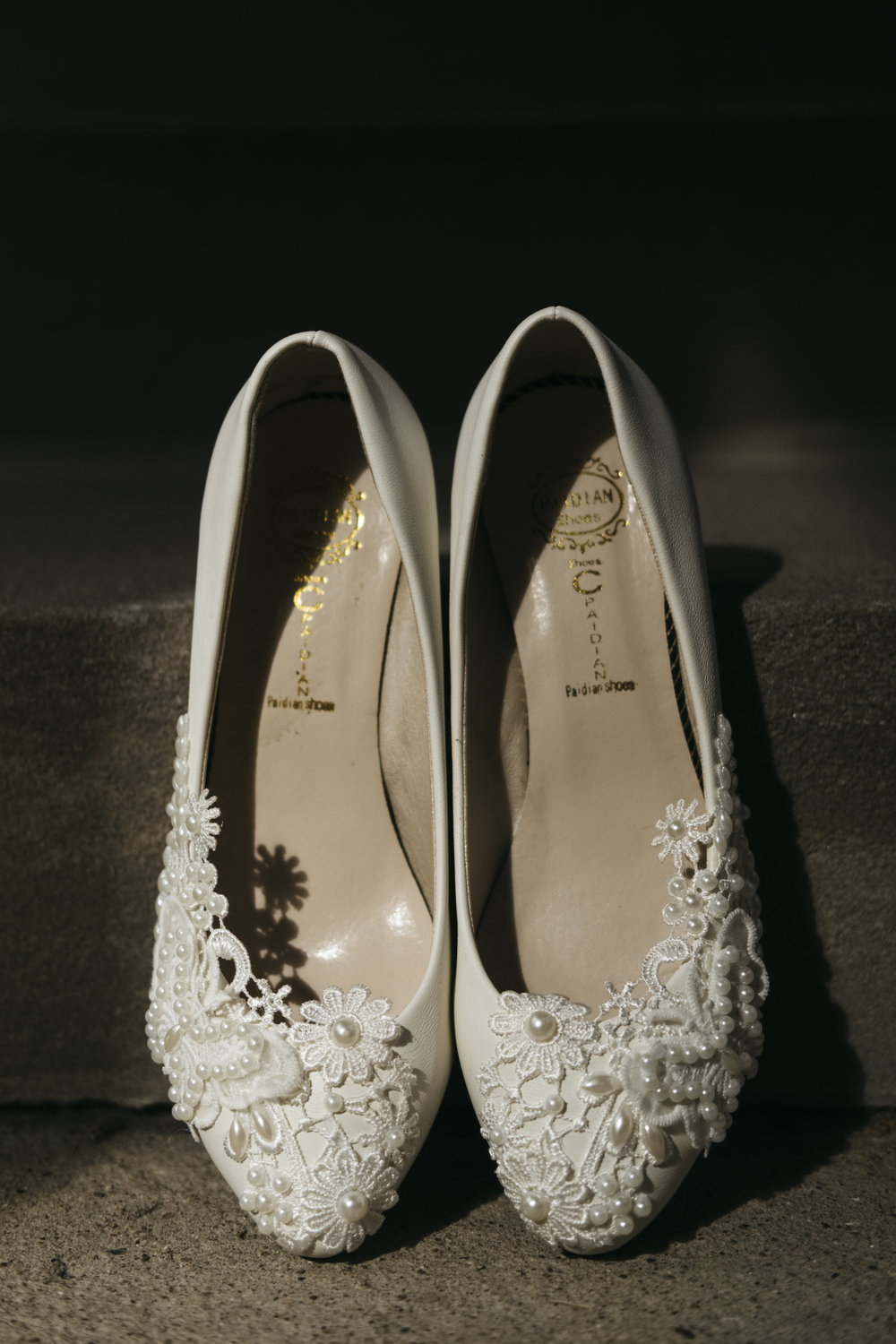 The bride's shoes came with lace detailing, floral, and pearls for her Ohio wedding ceremony