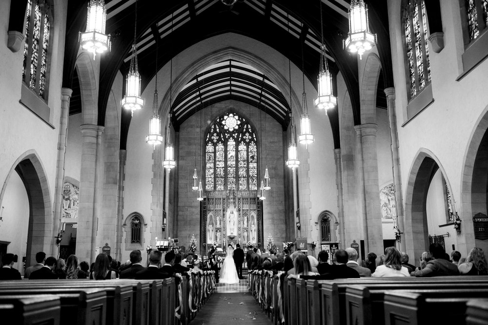 Bride and groom stand at the alter for their wedding ceremony at Grace Lutheran Church in Northern Ohio