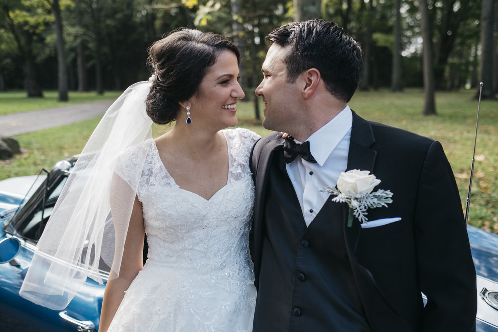 Bride smiles at the groom for her vintage inspired wedding in Fremont Ohio. Her hair is done by Pin Ups Hair Salon