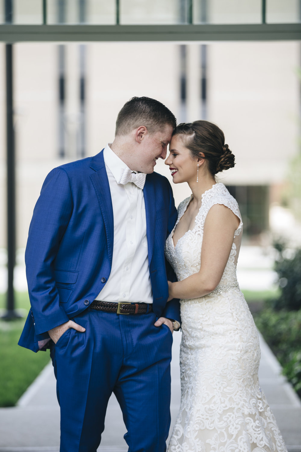 Bride and groom share an intimate moment before their wedding ceremony on Bowling Green Ohio's campus