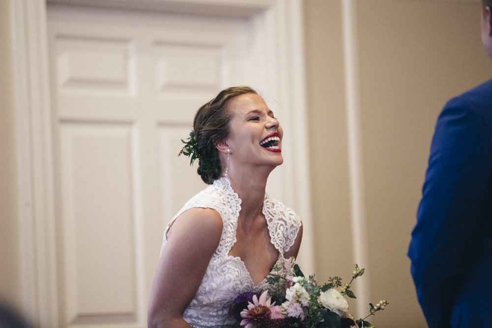 Bride laughs and smiles at the groom during her wedding ceremony at BGSU