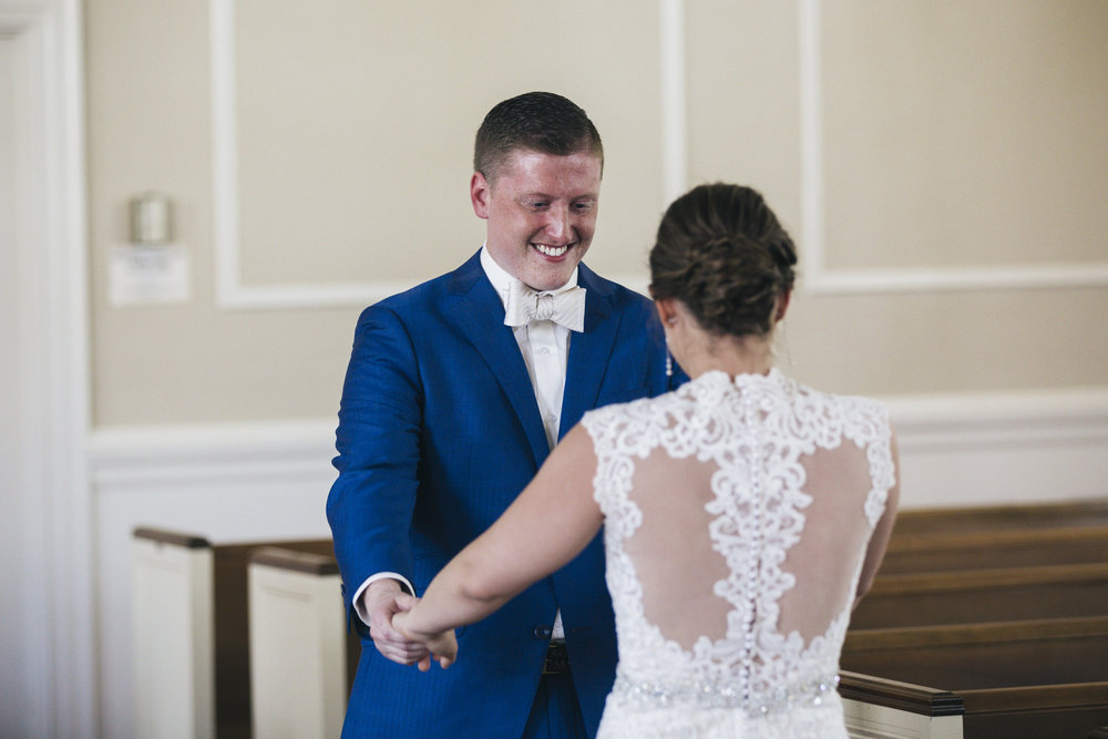 Groom sees his bride for the first time at Prout Chapel in Bowling Green Ohio