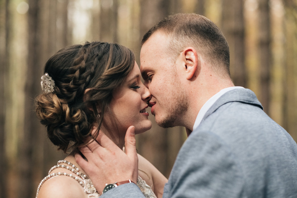 Bride and groom go in for a kiss at Oak Openings Park near Toledo Ohio