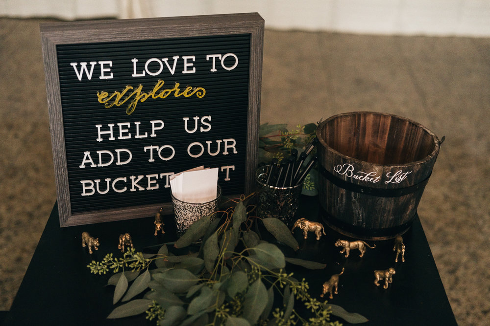 Bucket list and animal adventure themed wedding decor at The Registry Bistro in downtown Toledo