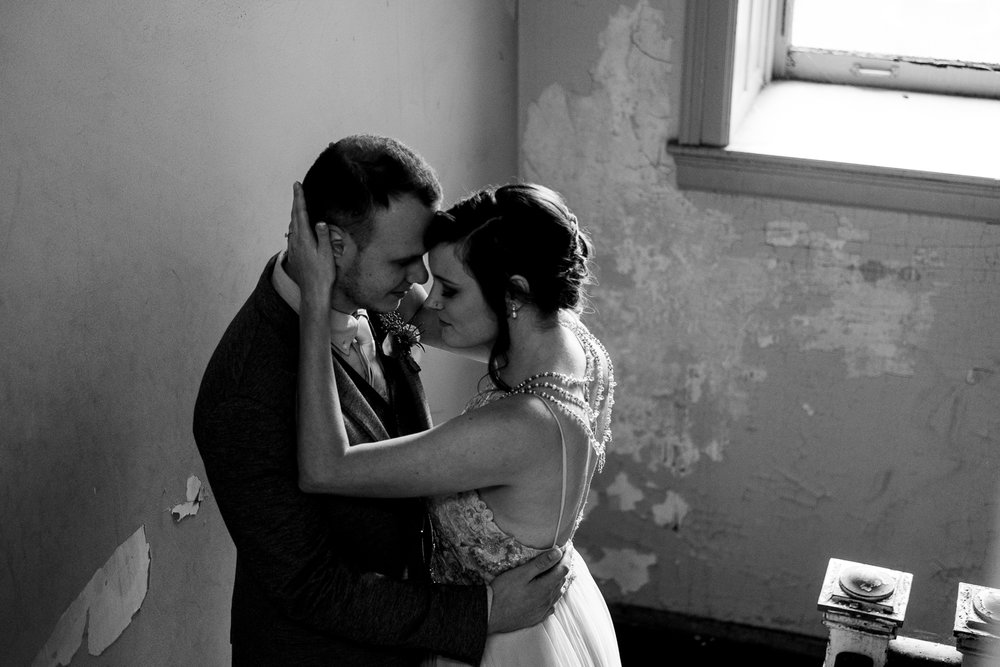 The bride and groom share an intimate moment at The Registry Bistro before their wedding ceremony in downtown Toledo