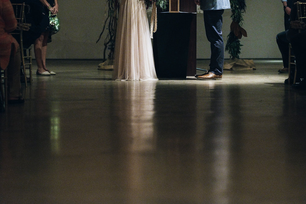 THe feet of the bride and groom at the alter at their wedding ceremony in Toledo