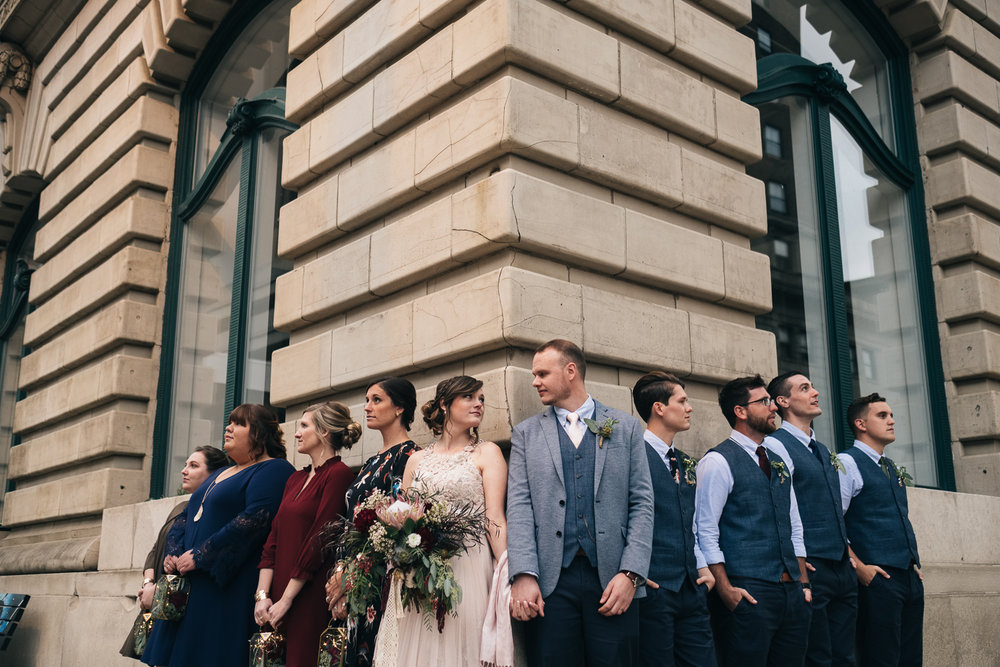 Bridal party lines up outside The Registry Bistro for wedding pictures by Toledo Wedding Photographers Swatch Studios