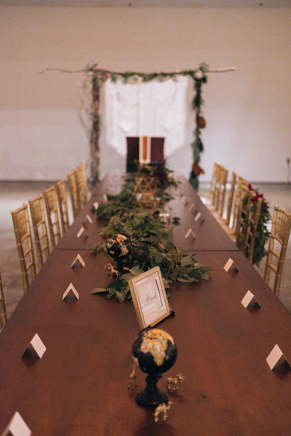 A long center table is where the bridal party and family will sit for this Toledo Ohio fall wedding