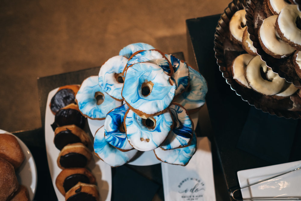 Donuts as a cake replacement is a good way to keep your wedding fresh and fun