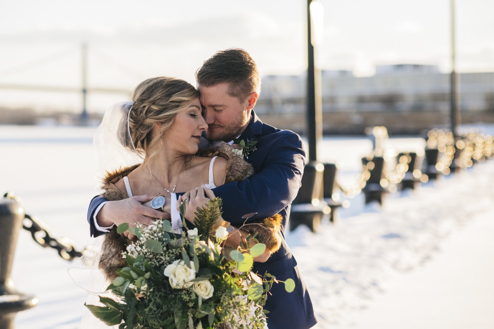 Snowy winter wedding photography in Downtown Toledo.