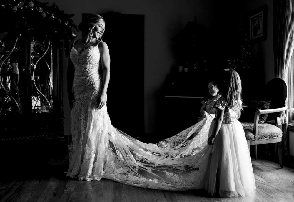 Bride with her flower girls on wedding day.