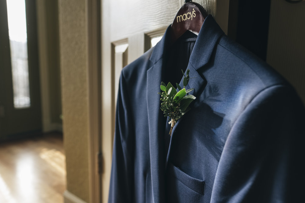 Blue suit for groom on wedding day.