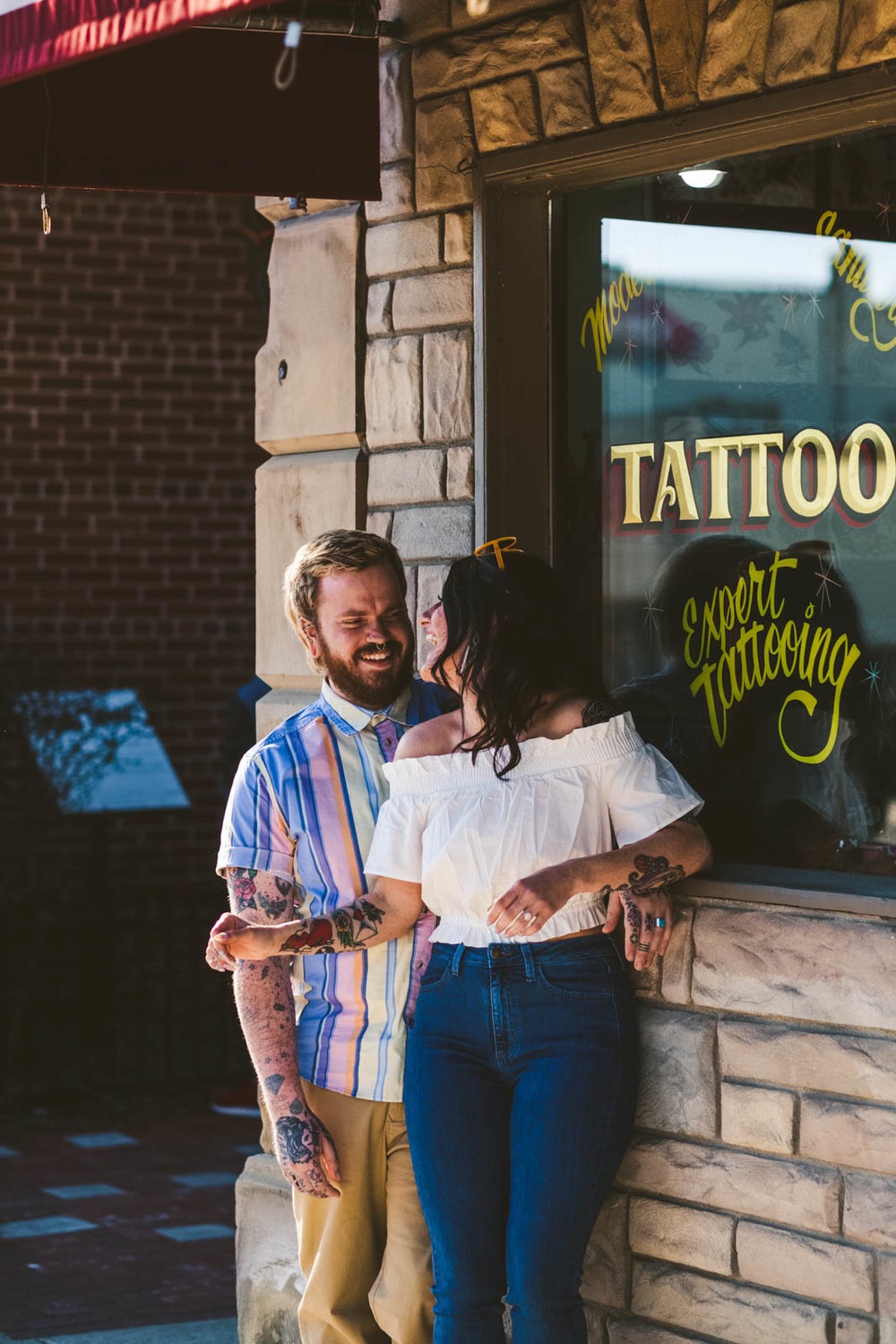Engaged Couple shoots at Tattoo Shop