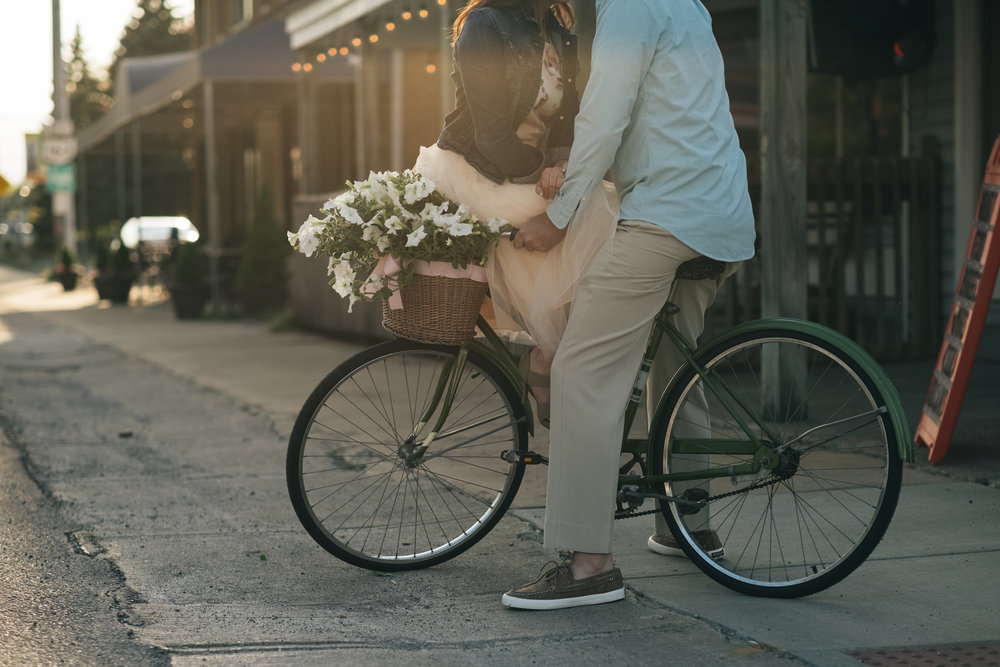 Engagement Session Photos with Old Fashioned Bikes and Flowers