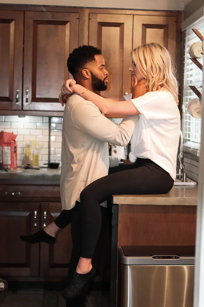 Couple sits in Kitchen for an In Home Photography Session