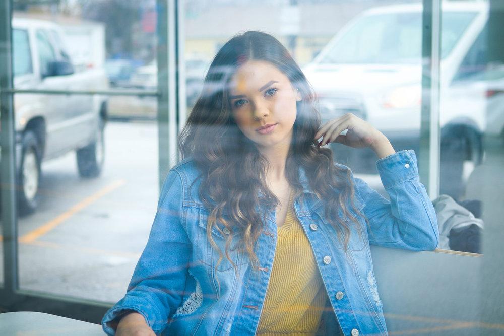 Model Looks Through Window for Fun Photo Session