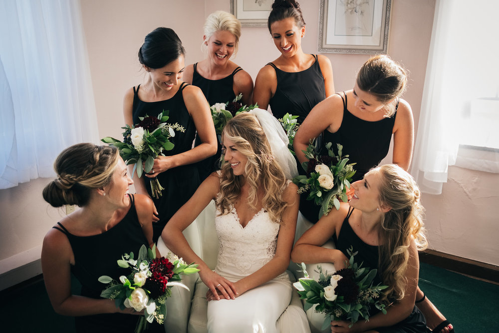 Bridesmaids Gather Around Bride on Wedding Day for Wedding Photographers