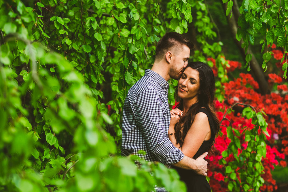 Couple at Toledo Botanical Gardens Pose for Toledo Wedding Photographers for Engagement Session