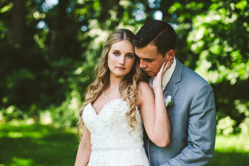 Bride and Groom Pose for Toledo Wedding Photographers at Stone Ridge Golf Club in Bowling Green Ohio
