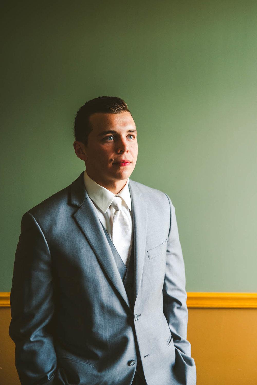 Groom Poses for Toledo Wedding Photographers on Wedding Day at Stone Ridge Golf Club