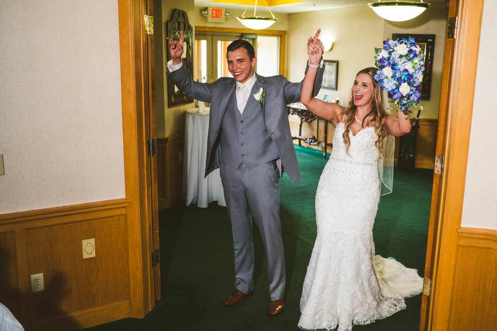 Bride and Groom enter Wedding Reception at Stone Ridge Golf Club with Toledo Wedding Photographers