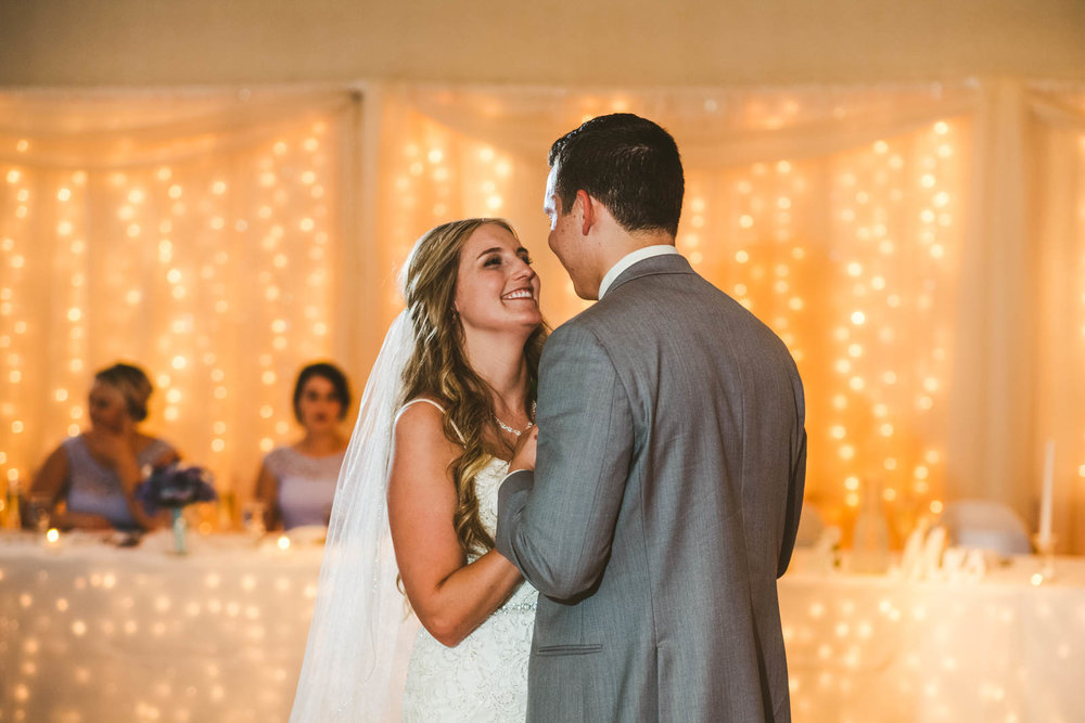 Toledo Wedding Photographers Capture Bride and Groom's First Dance at Stone Ridge Golf Club