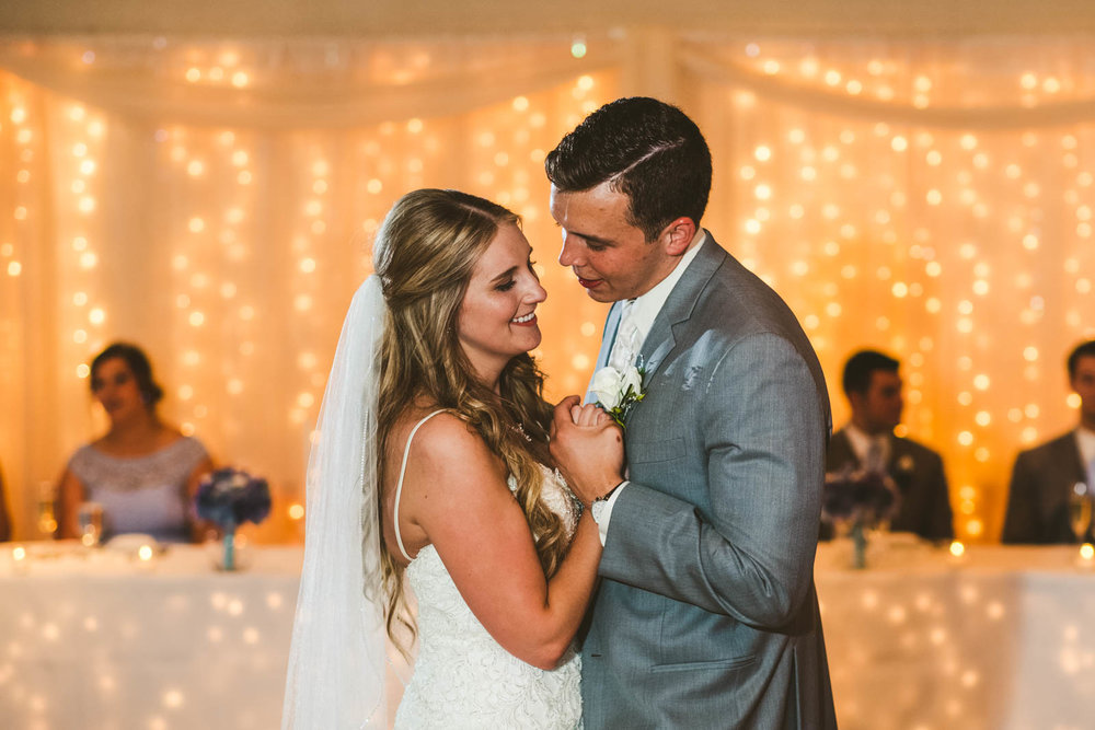 Bride and Groom Share First Dance at Stone Ridge Golf Club Wedding Reception with Toledo Wedding Photographers