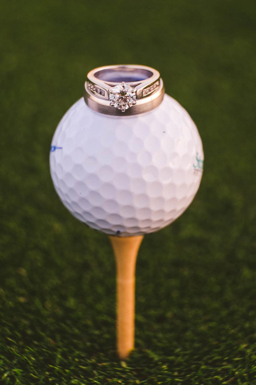 Photo of Wedding Rings on Golf Tee at Stone Ridge Golf Club