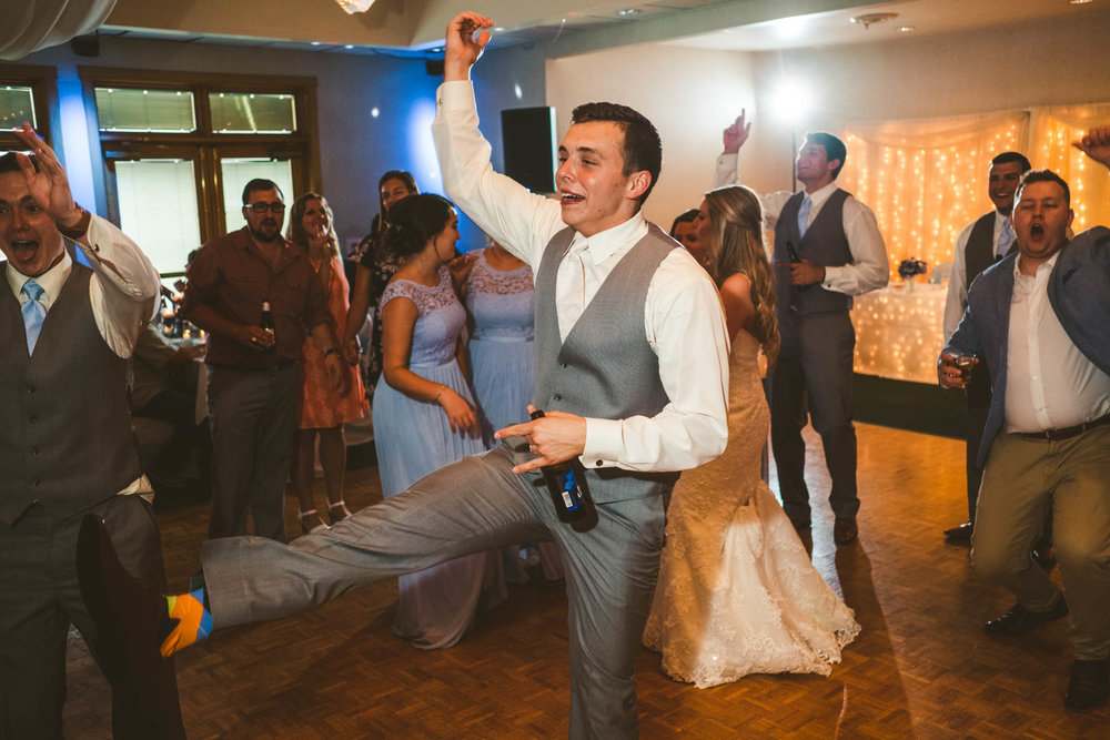 Groom Dances at Reception with Bride and Toledo Wedding Photographers at Stone Ridge Golf Club
