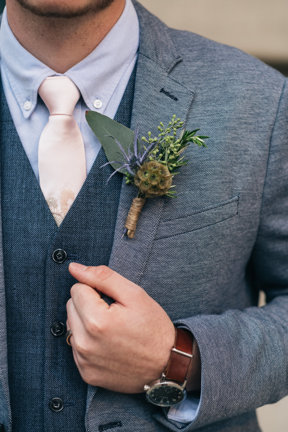 Groom with Floral Designs from La Boutique Nostalgie at Wedding in Toledo Ohio