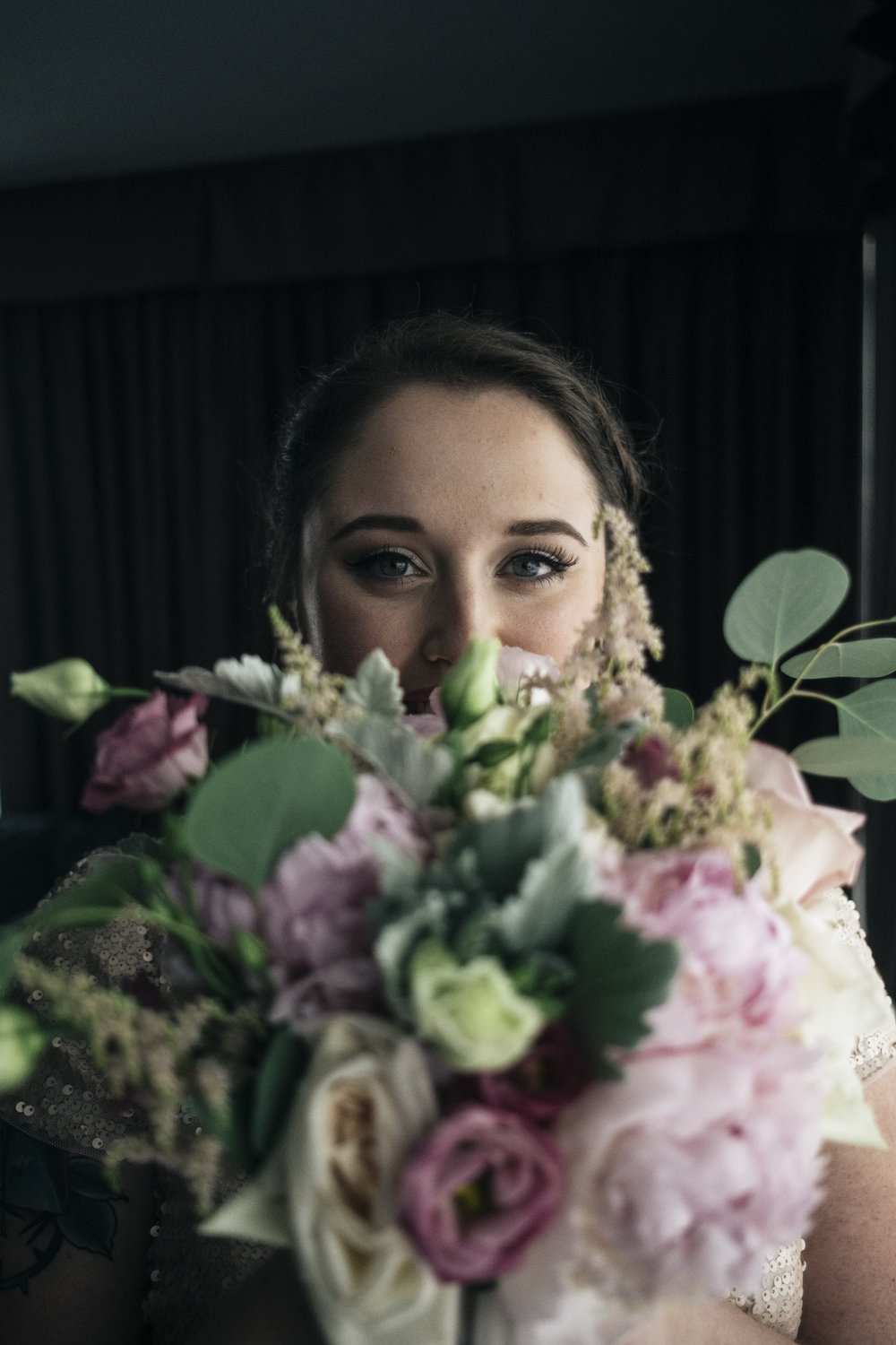 Bride and Bouquet Designed by La Boutique Nostalgie with Toledo Wedding Photographers on Wedding Day