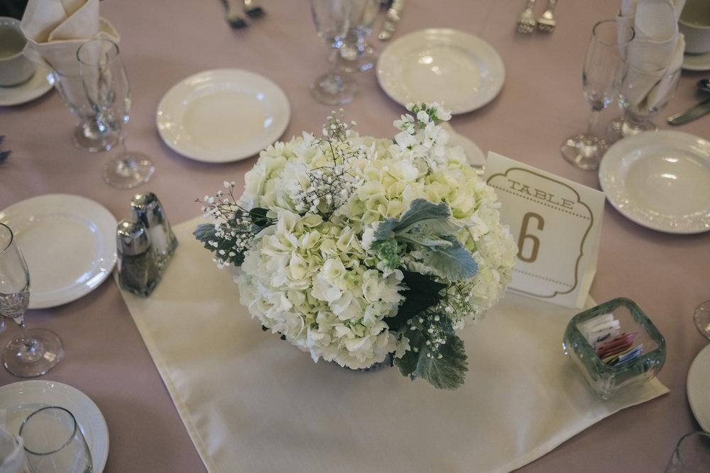 Floral Centerpiece at Wedding with La Boutique Nostalgie and Toledo Wedding Photographers