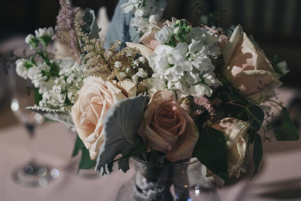 Floral Design by La Boutique Nostalgie at Wedding Reception with Toledo Photographers